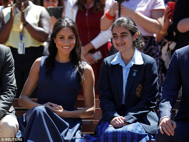 Fashion fans noted Meghan's choice of colours perfectly complemented the Macarthur Girls High School uniform, pictured. The royal couple spent time meeting local schoolchildren