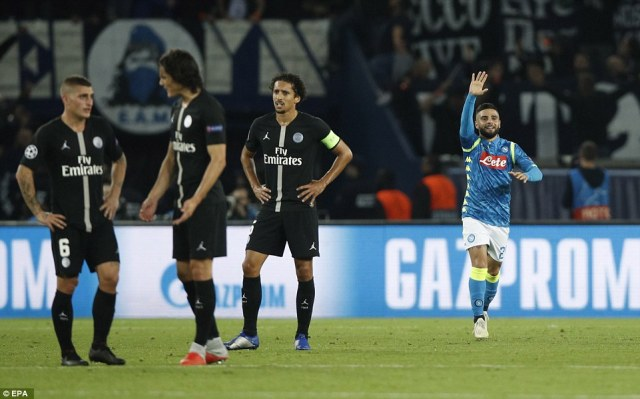 Insigne makes his way back to his side's half as Paris Saint-Germain players express their frustration after going behind