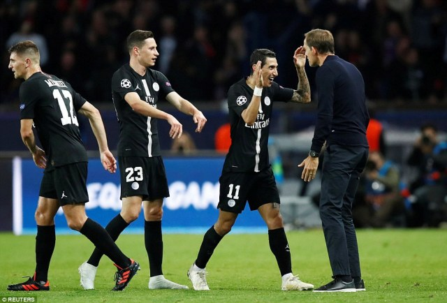 Di Maria (2nd right) is congratulated by manager Thomas Tuchel (right) after scoring a vital goal for the French champions