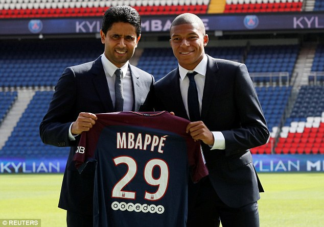 Mbappe poses with PSG boss Nasser Al-Khelaifi after being loaned out to the club in 2017