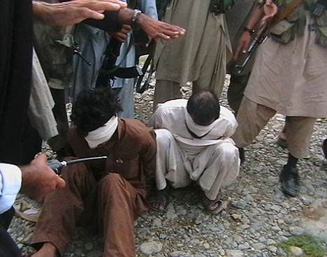 Pakistani Taliban get ready to execute the two Afghans - one a former Taliban fighter - accused of spying for the US