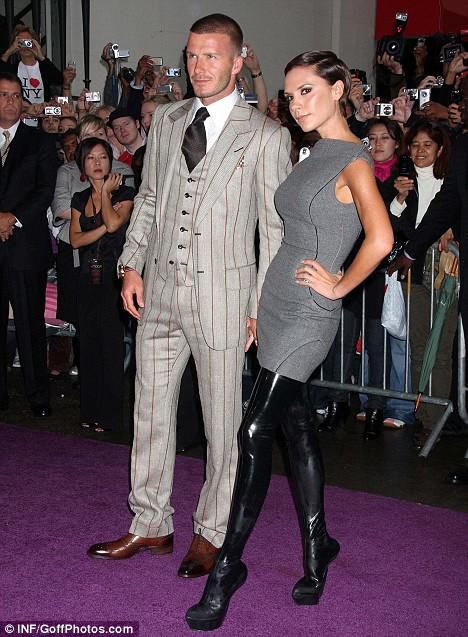 Victoria shows off her figure in thigh-high PVC boots as David goes for the classic option in a three-piece suit