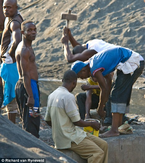 Congolese risk their lives digging through mountains of mining waste looking for scraps of metal ore