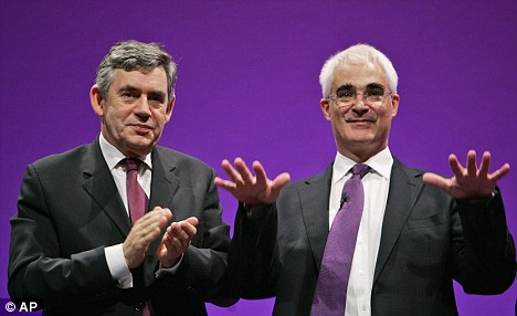 Labour conference: Chancellor of the Exchequer Alistair Darling, right, gestures to the audience to stop applauding him as Gordon Brown looks on