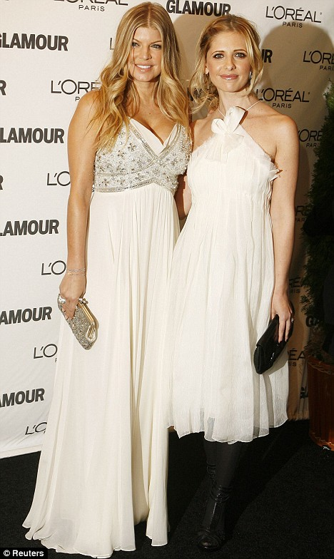 Singer Fergie (L) arrives with actress Sarah Michelle Gellar at the Glamour Women of the Year