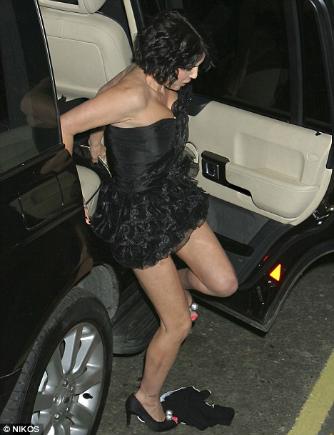 Getting in a twist? Sadie Frost drops what appear to be a pair of knickers as she climbs out of her car after last night's British Fashion Awards