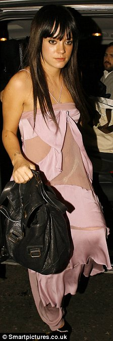 Lily Allen pictured leaving Damien Hirst Christmas Party dress in a torn pink dress