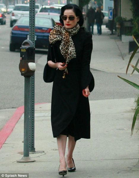 Polished: Dita Von Teese in towering heels for her journey home