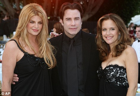 Kirsty Alley, pictured with Travolta and Kelly Preston, is flying to the family home in Florida to await the actor's return
