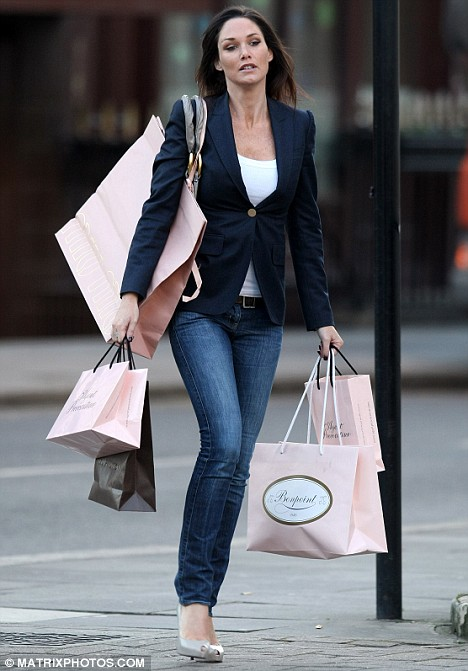 Claire Merry ex-wife of former Arsenal star Thierry Henry, shops for some 'va va voom' lingerie at an Agent Provocateur store during a shopping spree in London yesterday