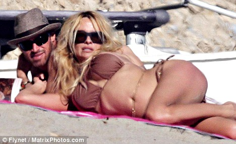 Pamela Anderson is pictured with her new boyfriend out on the beach in Malibu