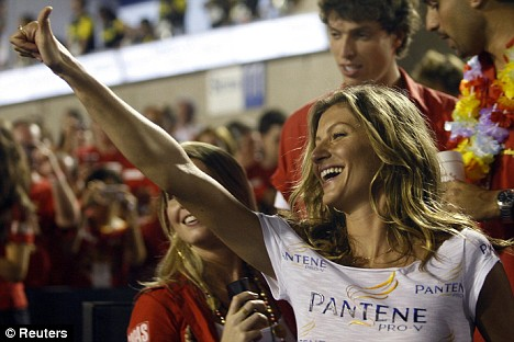 Party girl: Just five days before her wedding, Gisele was partying at Rio De Janeiro's carnival
