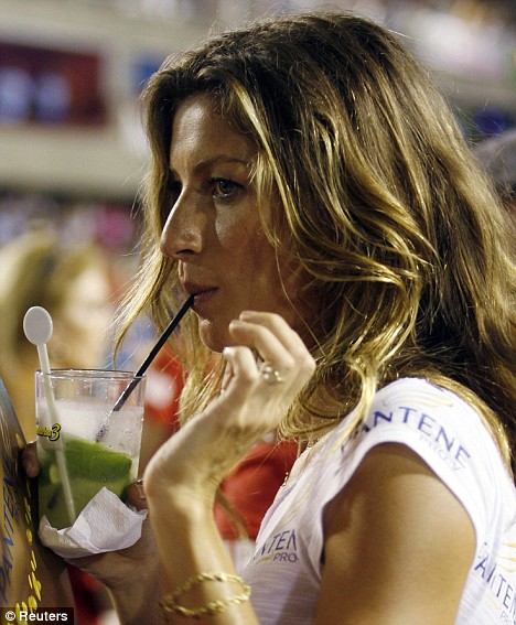 Brazilian model Gisele Bundchen watches the first night of the Carnival