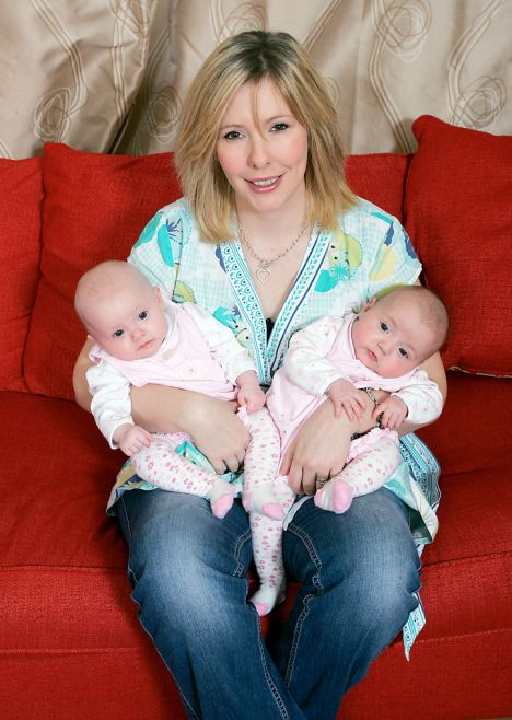 Rachel Crossland with her four-month-old twins Saffron, left, and Poppy