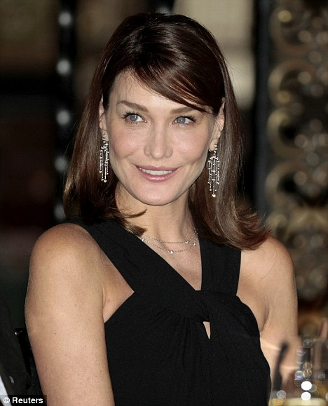 Elegant: Carla Bruni glitters in a diamond necklace and earrings at the dinner in Mexico