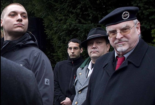 Gottfried Kussel (second from right) among the gathering at the grave of WWII Nazi pilot Walter Nowotny