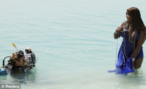 Despite having to wade into the water, the singer appeared to be enjoying the shoot with British photographer Candice