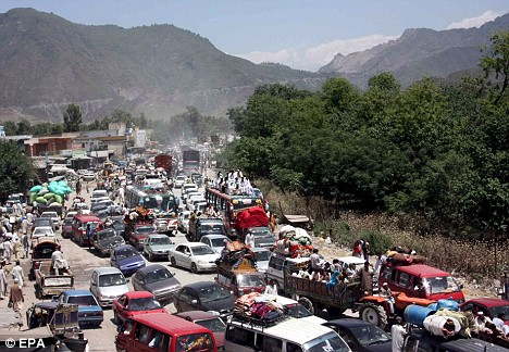 Thousands of people flee fighting between government forces and Taliban insurgents in Pakistan's Swat valley