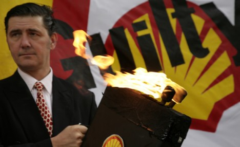 Flames of unrest: Shareholders staged an angry protest over executive pay outside Shell's AGM yesterday
