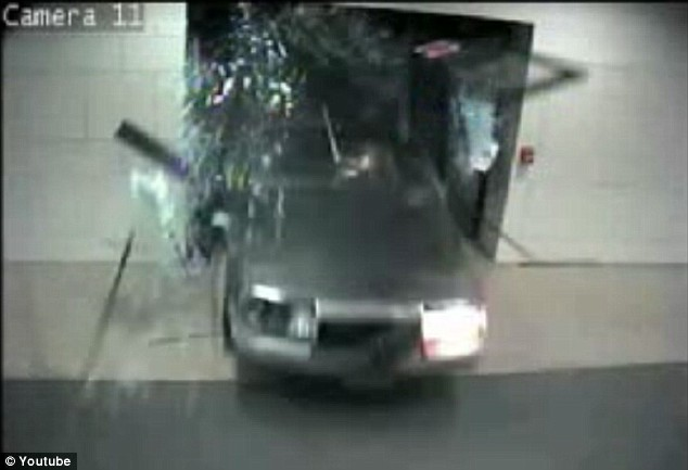 a man drives through Wichita city hall, taken from Youtube video