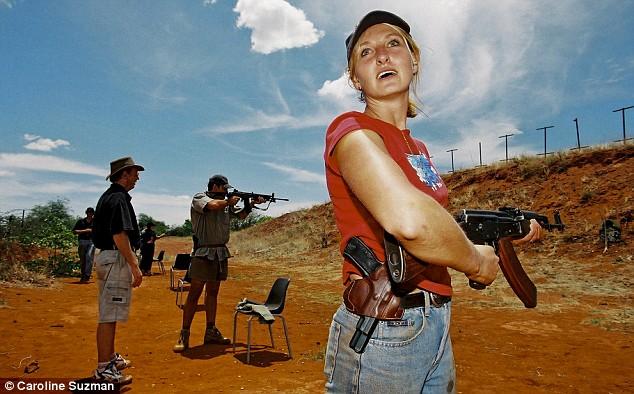 Farmer's wife Ida Nel learns how shoot an AK-47 and a pistol