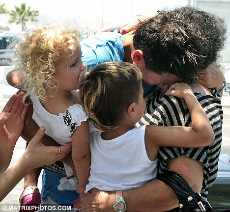 Tender embrace: The singer, who was joined by daughter Princess and son