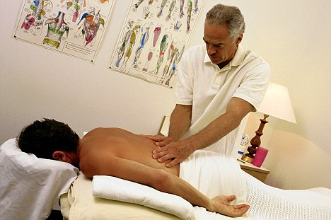Chiropractor with patient