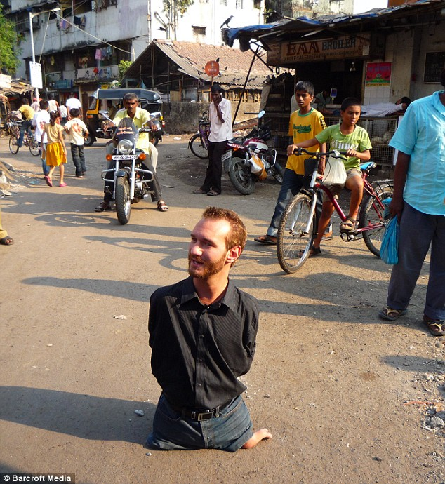 Nick pictured during his travels in India. He has visited 24 different countries, touring the world as a motivational speaker