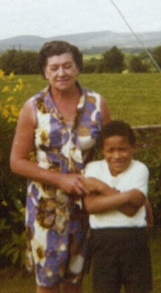 Unrecognisable: Luke aged six with his foster mother
