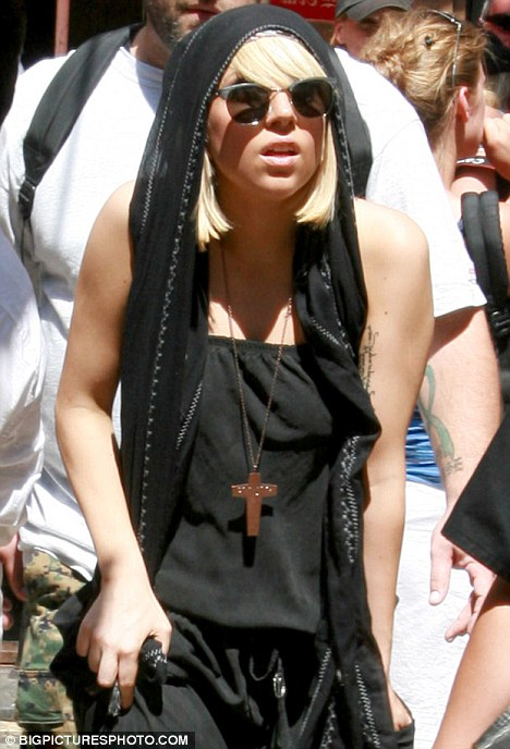 Lady Gaga wearing a cross