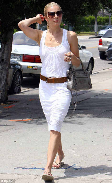 All white: The 26-year-old pictured shopping in Los Angeles yesterday