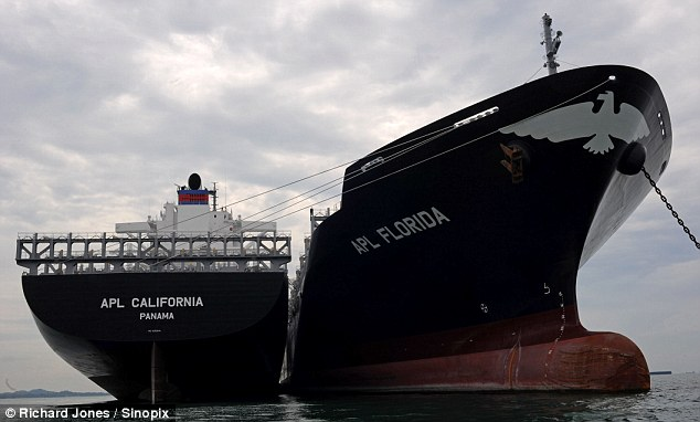 Two container ships tied together in Sungai Rengit, southern Malaysia