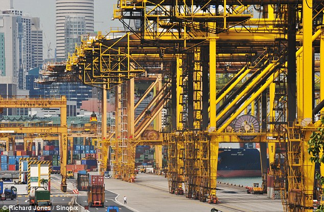 Cranes at Singapore Dock stand idle, waiting for work