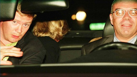 An image showing Princess Diana, rear with her head turned away, with her bodyguard Trevor Rees Jones, front left, and driver Henri Paul, in the car shortly before the crash in 1997. Dodi Al Fayed is also in the car although he is not seen