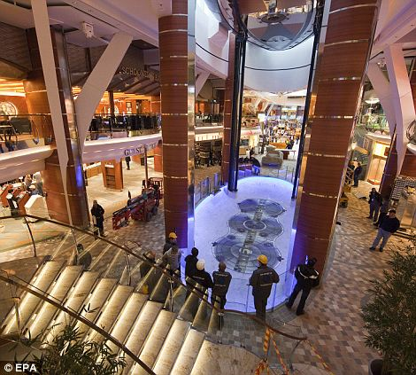 Interior of the huge ocean liner which boasts 21 swimming pools, an aqua park, a carousel, a rock climbing wall and a science lab