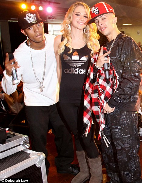 N-Dubz: Dino (Dappy) Tula (Tulisa) Richard (Fazer) performing at a school in Manchester. Police want to speak to the two male members