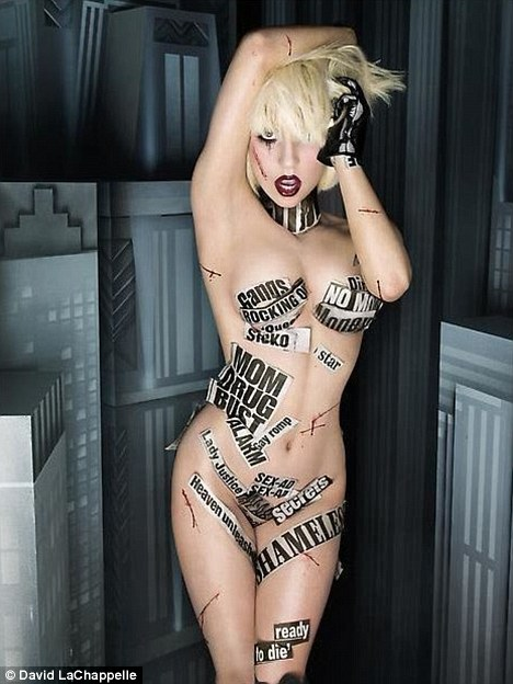 Headline act: Lady GaGa covers what little modesty she has left with newspaper cuttings for a new photo shoot