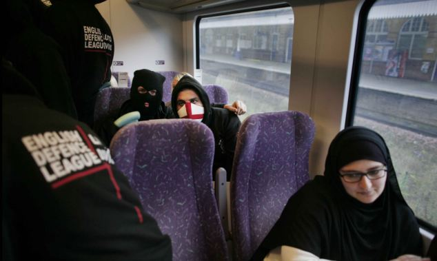 English Defence League protest march en route by train to Manchester from Bolton