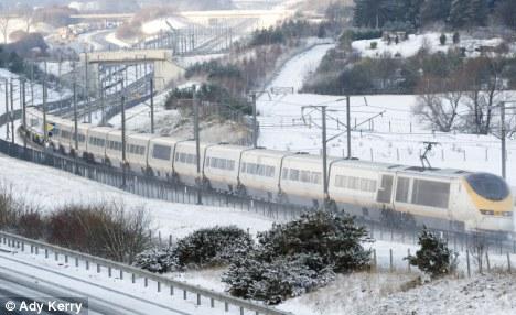 A Eurostar train makes its way through snow in Kent