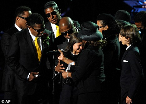 'Keeping faith': The Jackson family with Michael's children at his memorial service last year