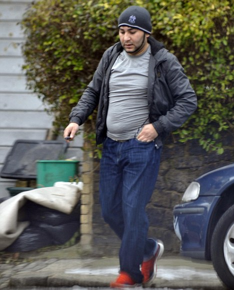One of the alleged Romanian gipsies 'Daniel' leaves the Mosedale's house in Tottenham