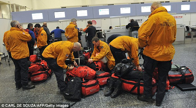 British Search and Rescue teams prepare to leave Gatwick airport, to provide assistance to relief and rescue teams in Haiti