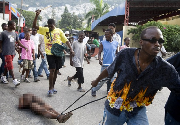 A man is lynched by a mob after he was accused of robbery in Petionville January 16, 2010
