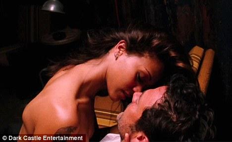 Zoe Saldana and Jeffrey Dean Morgan in a love scene in the film:  THE LOSERS