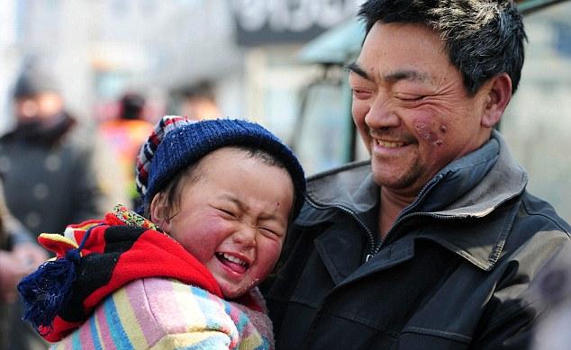 Father's pride: Rickshaw driver Chen Chuanliu with Lao Lu
