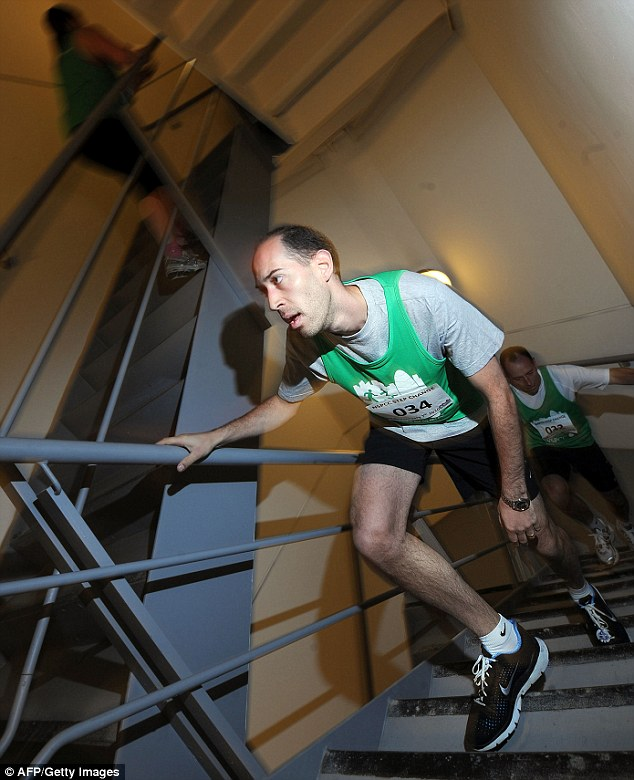 Long slog: More than 250 people raced up 38 floors inside the   Swiss Re Tower to raise money for the NSPCC