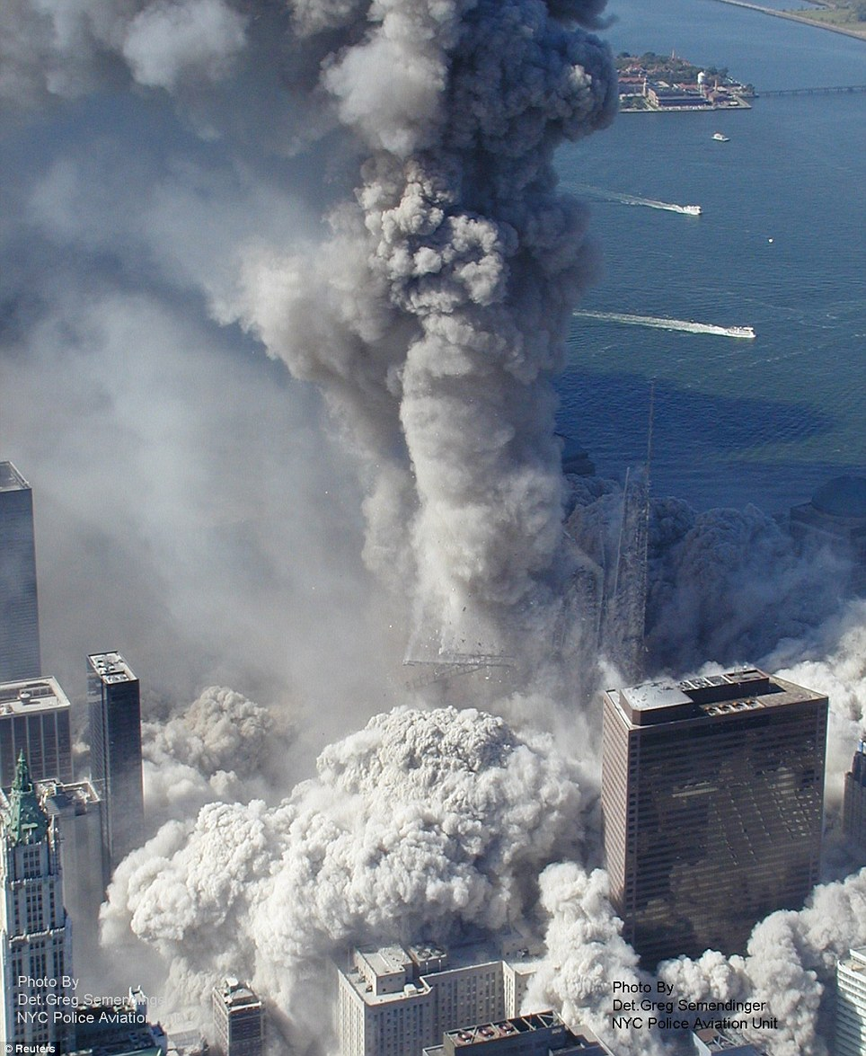 The moment one of the World Trade Centre towers begins to crumble in New York