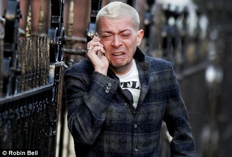 The blond man who said he was McQueen's boyfriend in tears outside his flat this afternoon as his body was put into a private ambulance