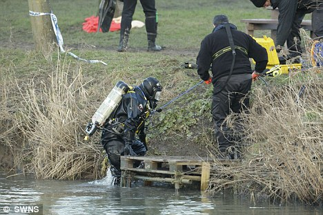 Police divers at the scene