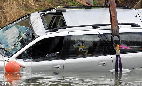 Children's toys could be seen on the back seat as the car was winched